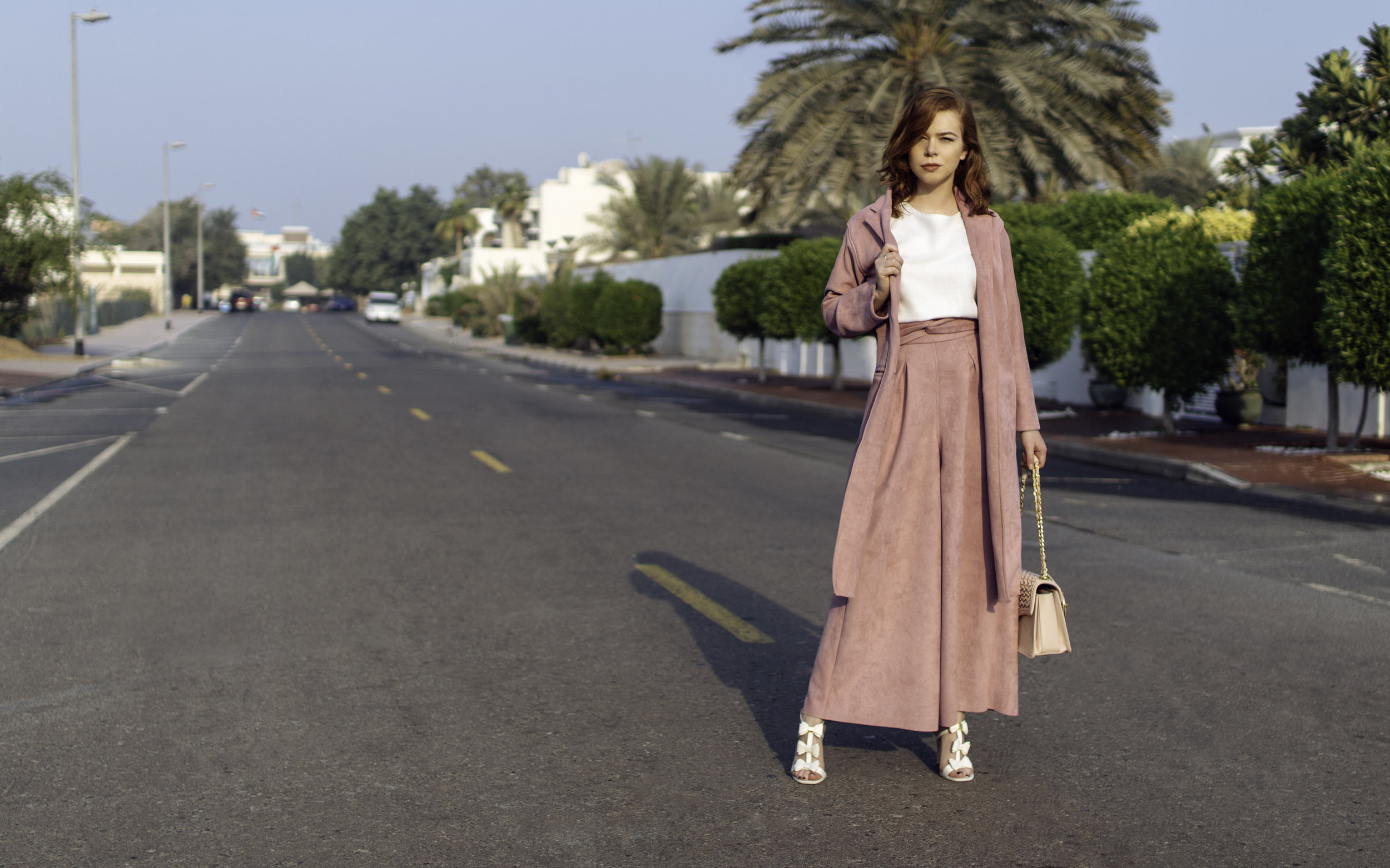 Photos taken in Jumeirah 2, Dubai. For today's chic office look I'm wearing an   incredible 3 piece, suede design by Yara Bin Shakar ,  Ted Baker flower heels and Valentino Orlandi handbag.