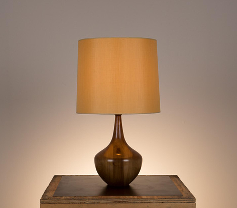 Bradley Table Lamp #1  Walnut in a medium brown finish. Semi-closed top lamp shade in gold silk.
