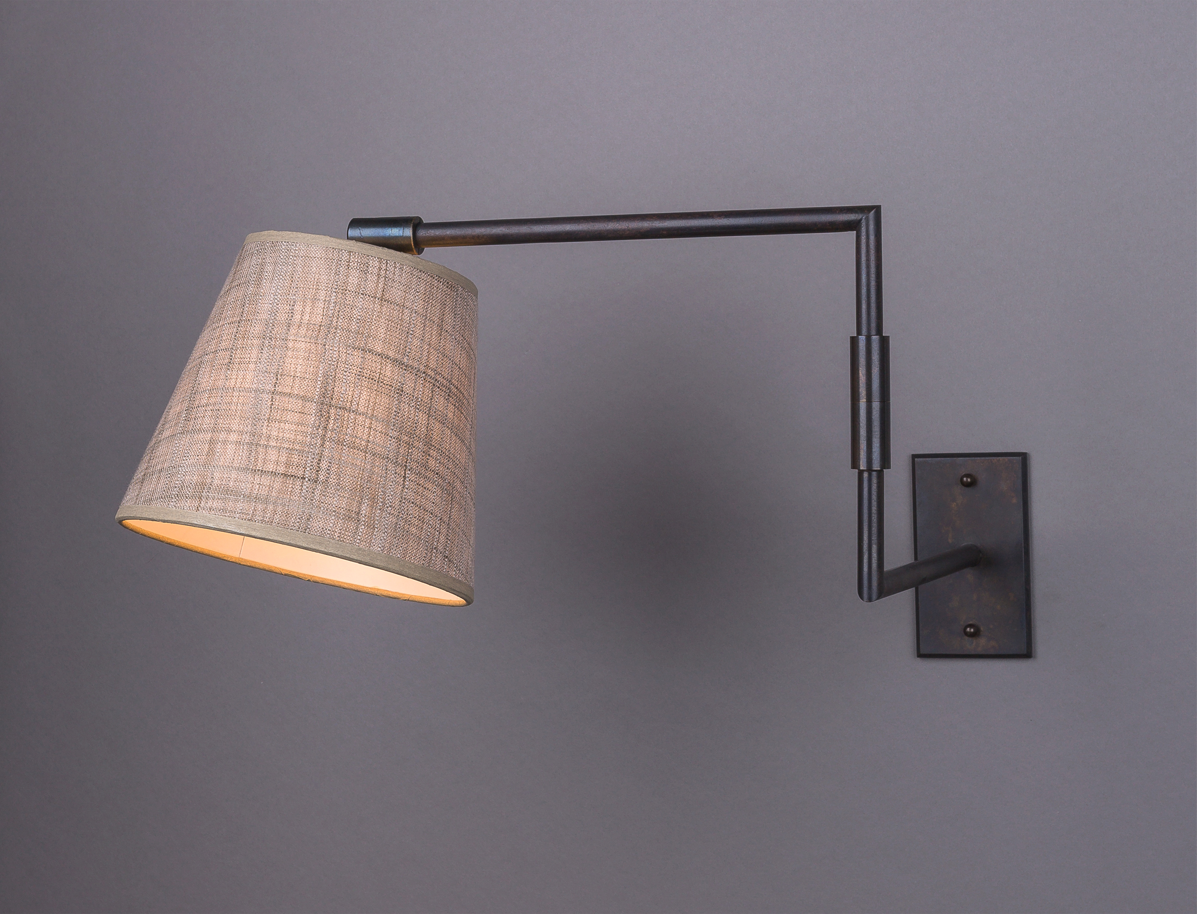 Jasper J Swing Arm   Distressed bronze / 260 beige linen shade.