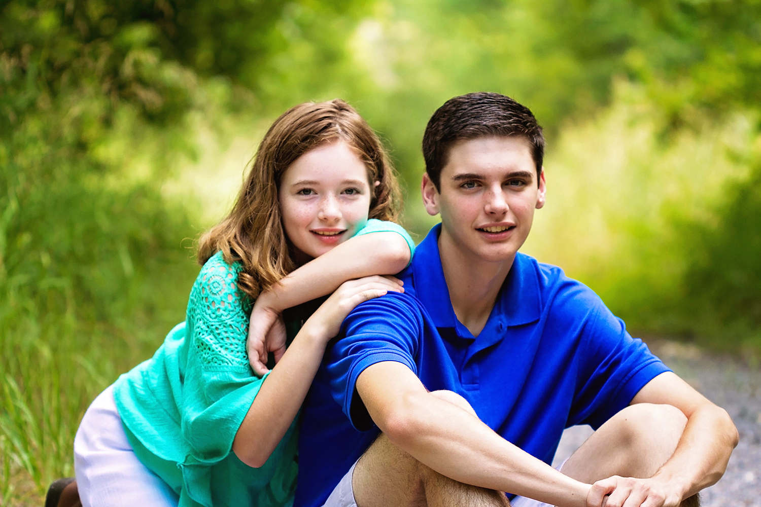sibling in green and blue on forest path.jpg