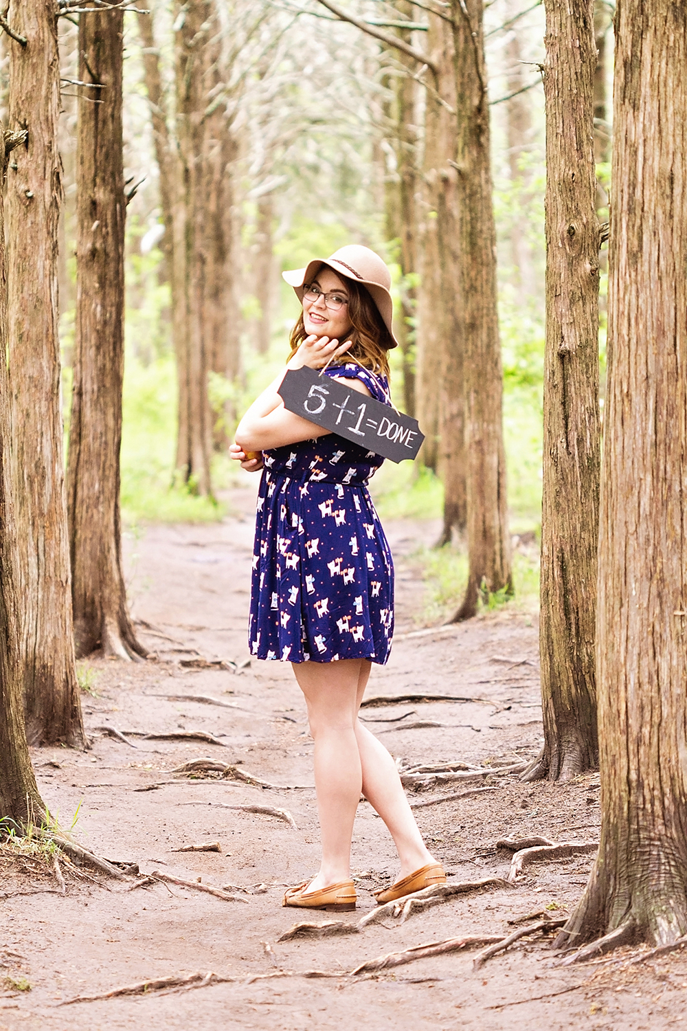 girl with sign in woods.jpg