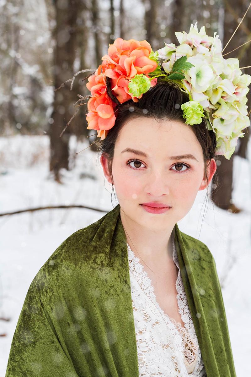 girl with brown eyes wearing floral crown in snow.jpg