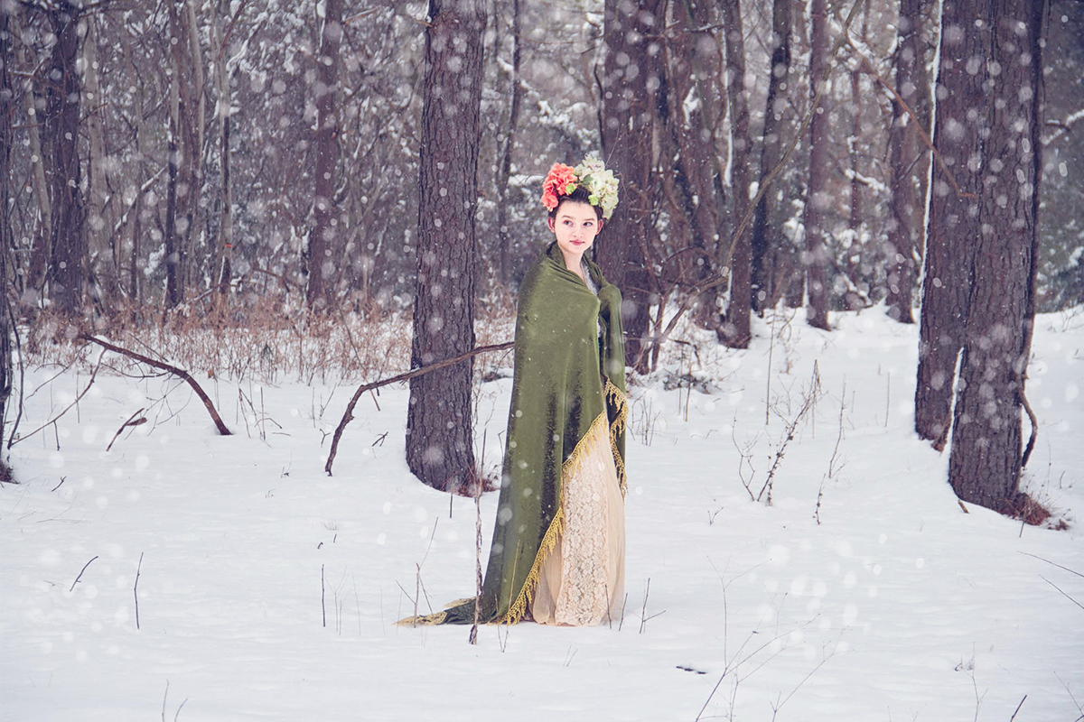 girl with floral hair in snowy forest.jpg