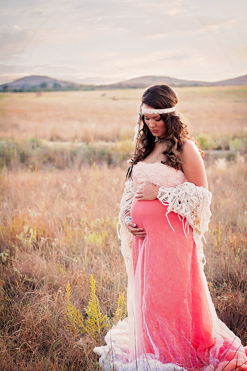 Bowmakers daughter multi racial pregnant indian woman dress in coral .jpg
