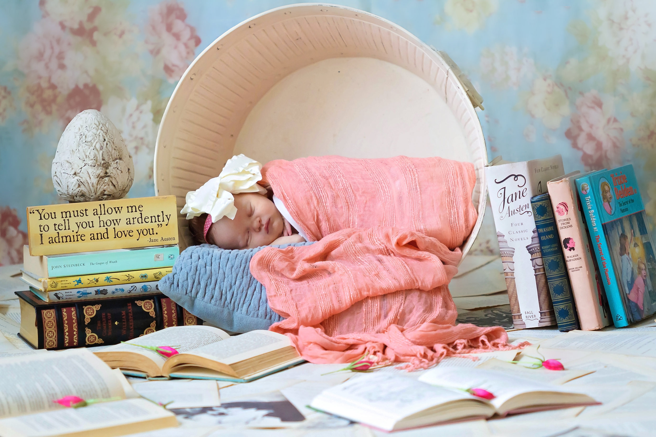 baby in pink surrounded by books.jpg