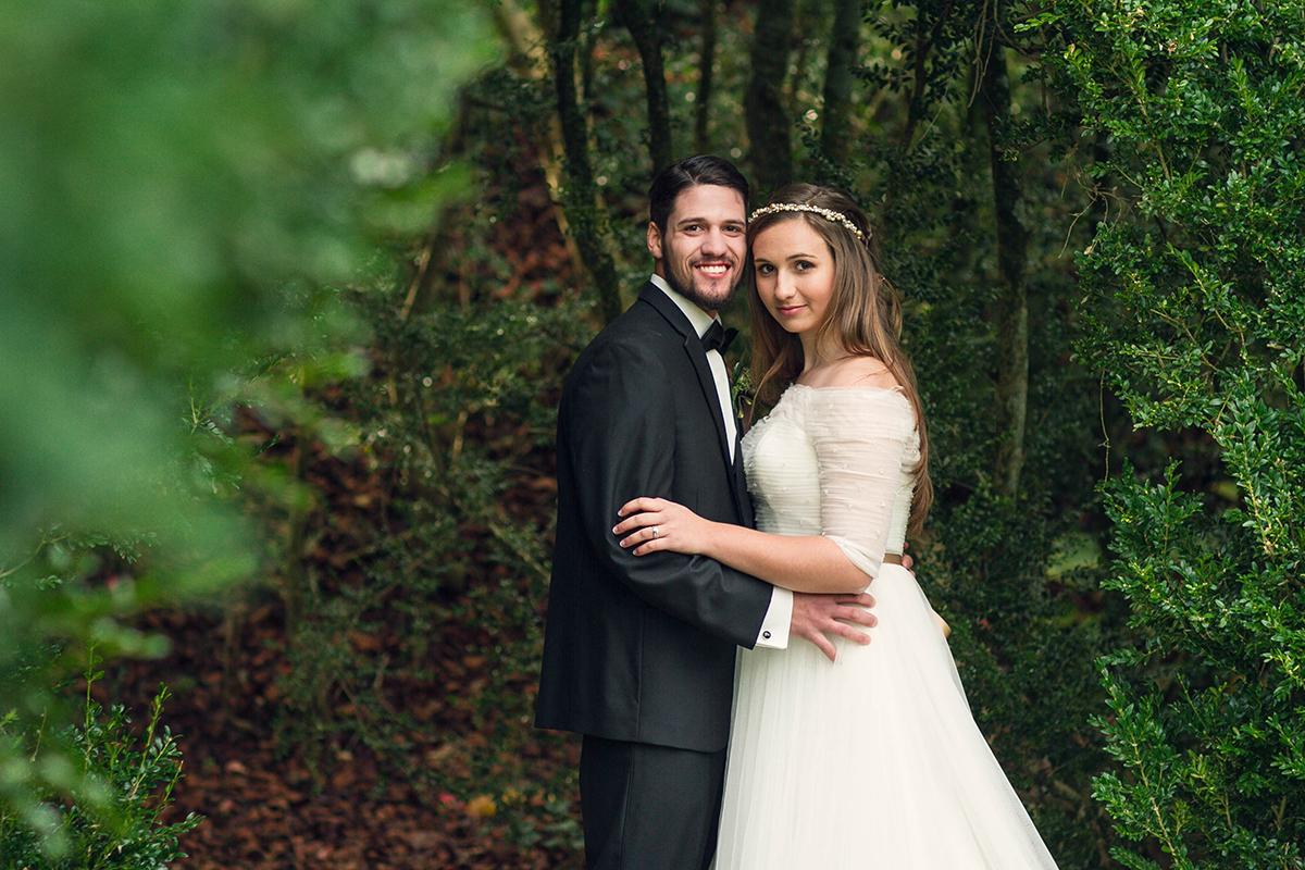 Interlocked wedding couple in the green forest.jpg