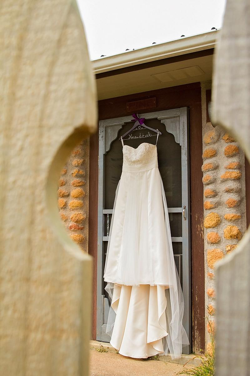 Brides dress thru picket fence.jpg
