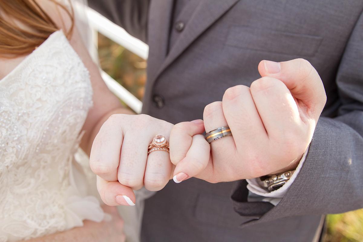Wedding couples pinkies interlocked.jpg