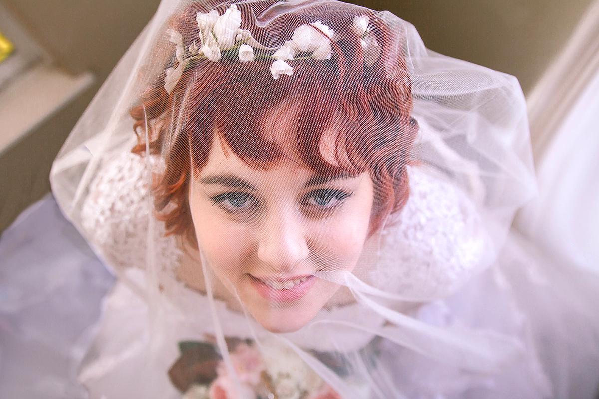 Bride looking up thru veil.jpg