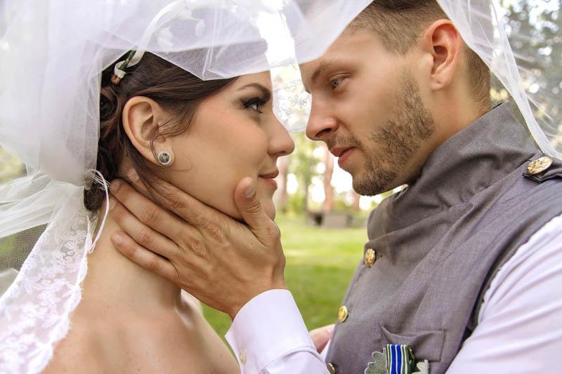 Wedding Couple standing under the veil.jpg