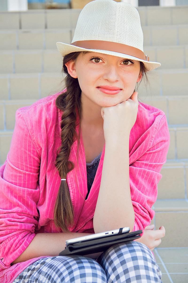 Pretty girl in pink on steps.jpg