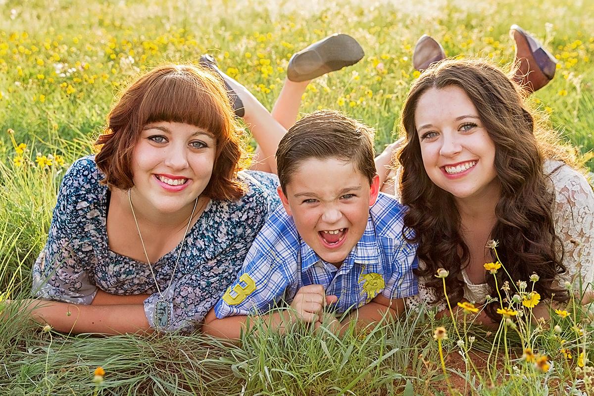 kids in a field of flowers
