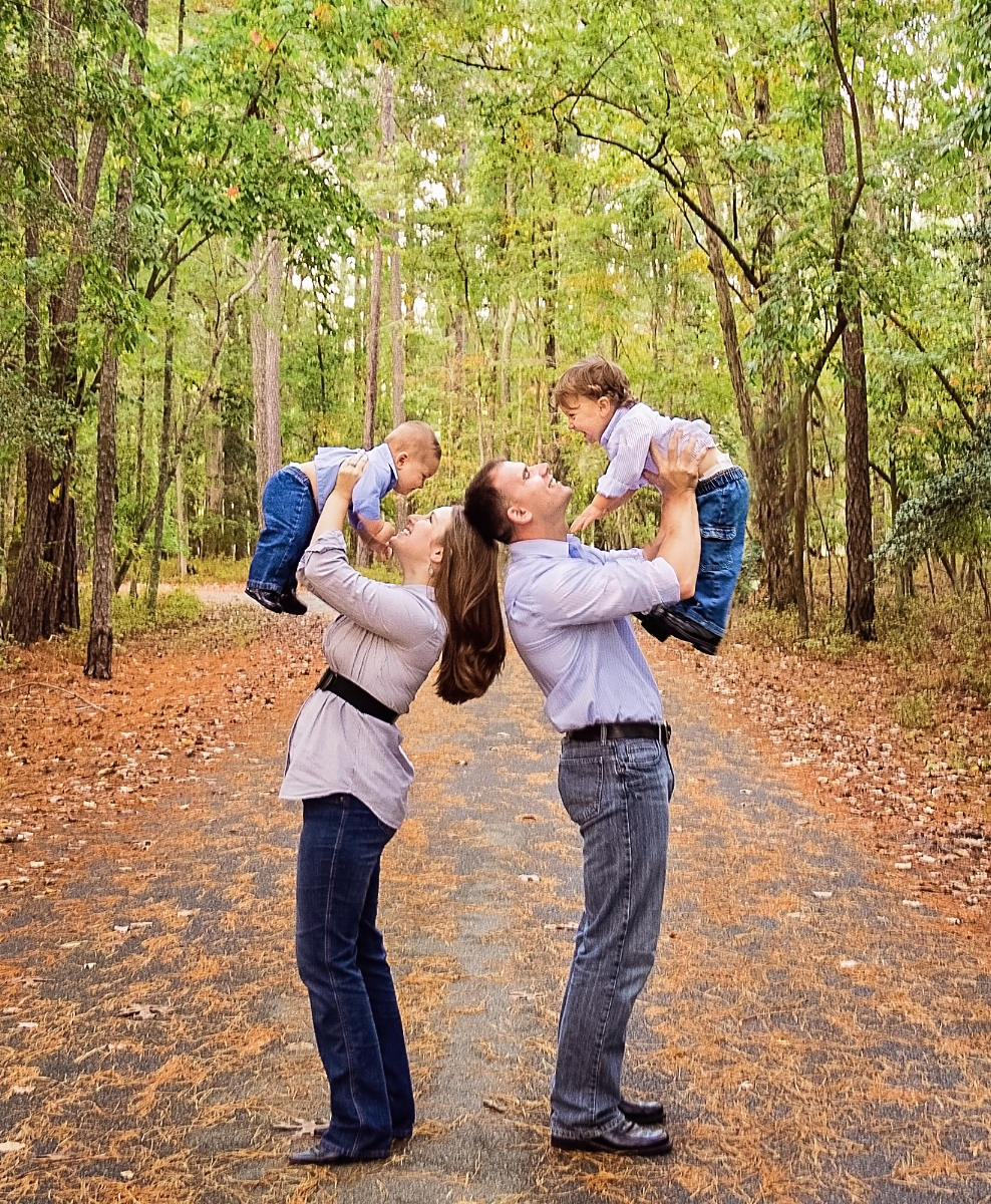 parents holding boys up in the air.jpg
