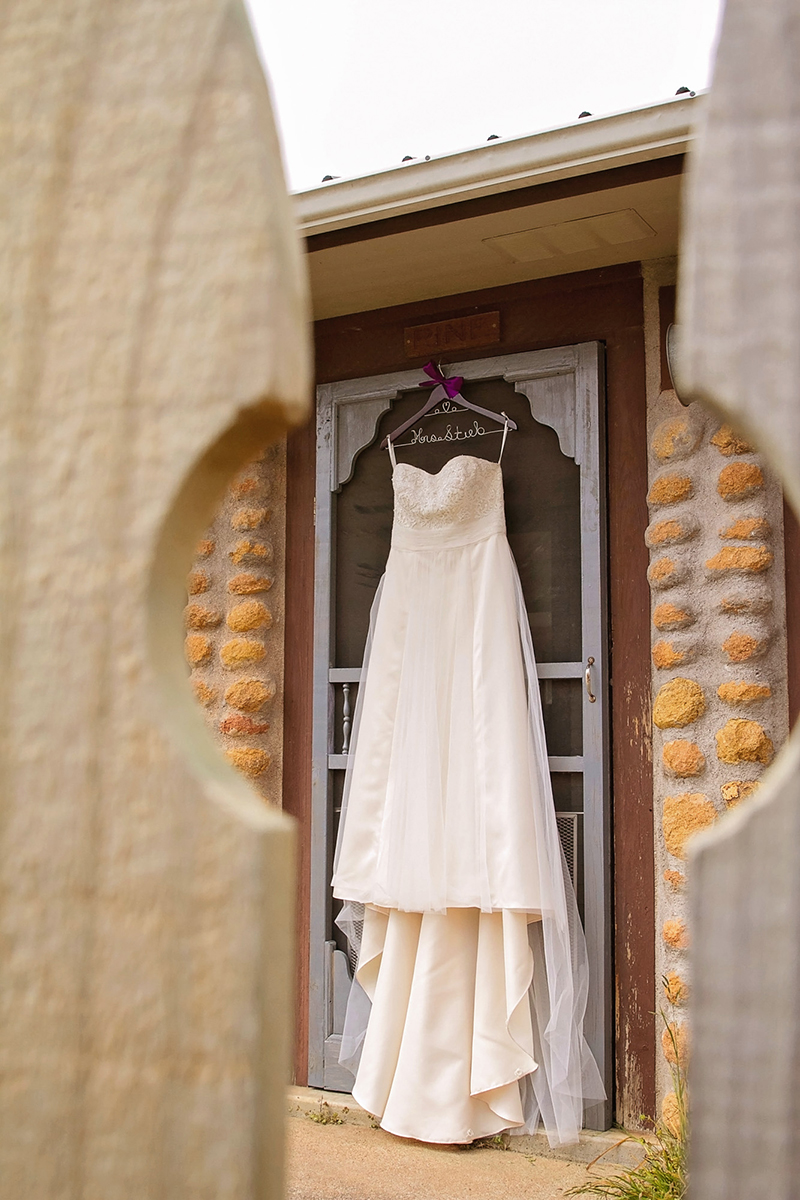 A wedding dress thru fence pickets.jpg