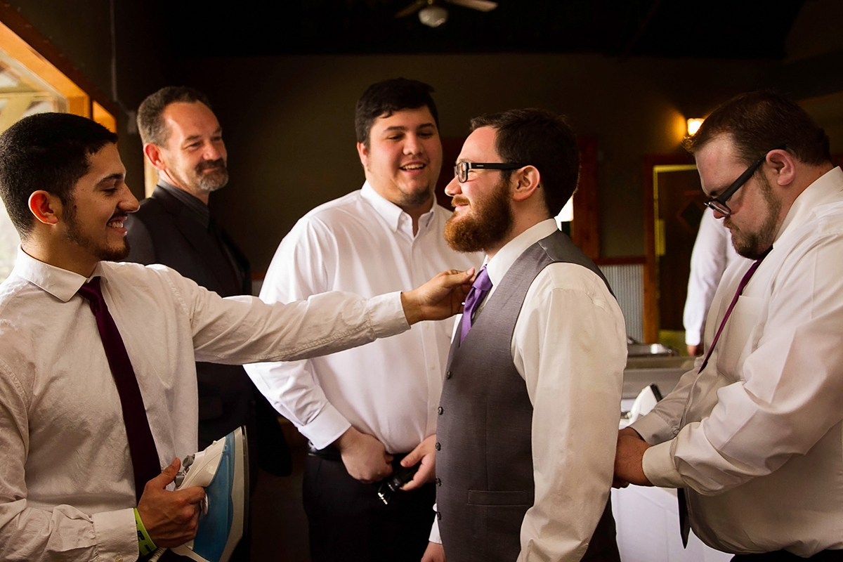 The groom getting ready with groomsmen.jpg