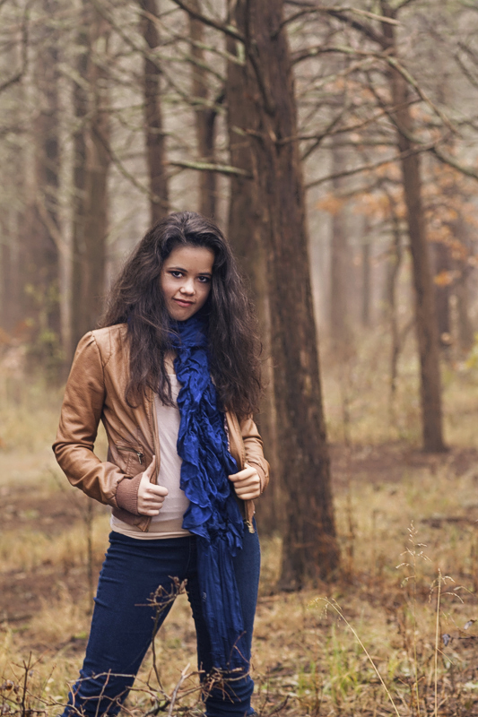 Senior Girl wearing leather jacket in the forest.jpg
