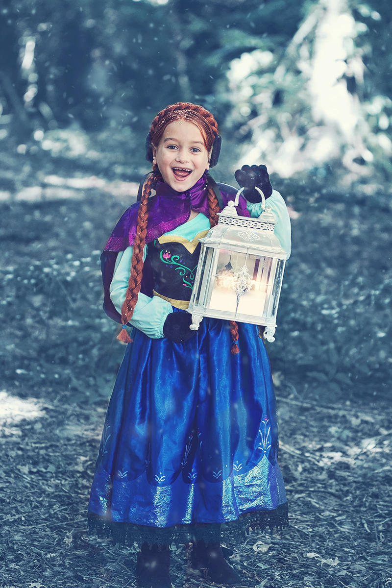 Frozen Themed Anna in forest with a light.jpg
