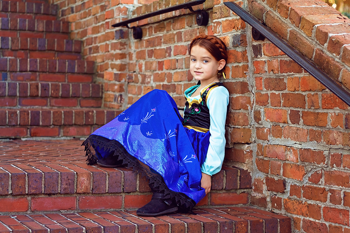 Frozen Theme Shoot Anna sitting on stairs.jpg