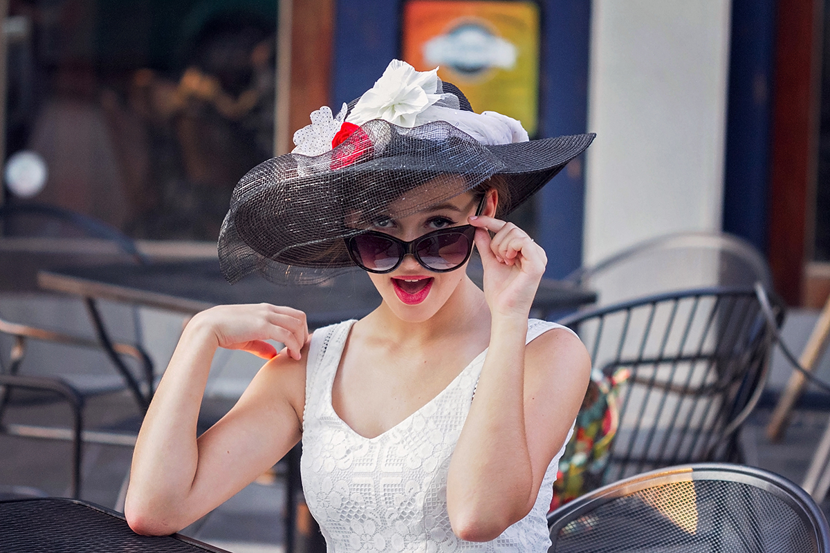 Audrey Hepburn styled session  girl pearing over sunglasses.jpg