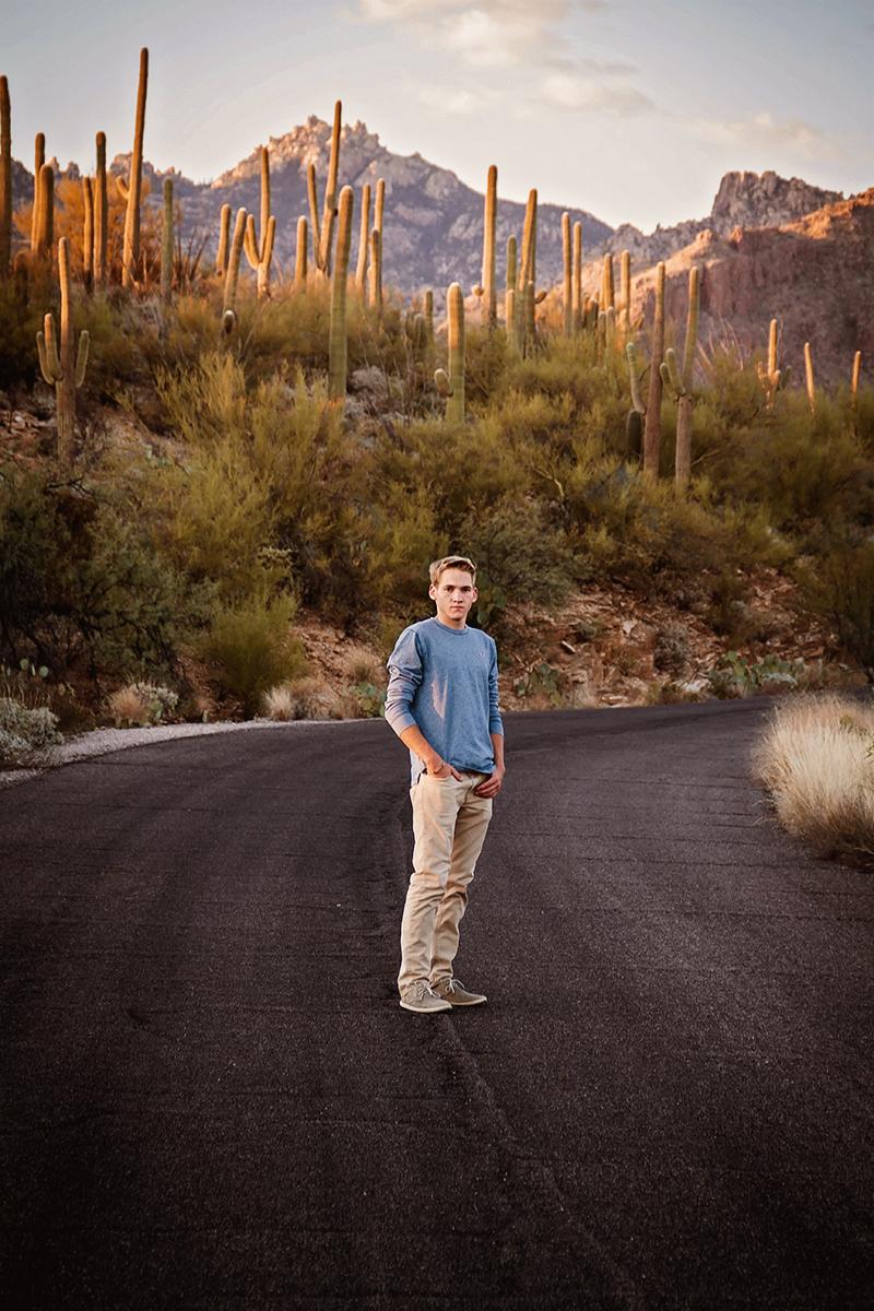 Arizona Senior Guy standing along a cactus lined road.jpg