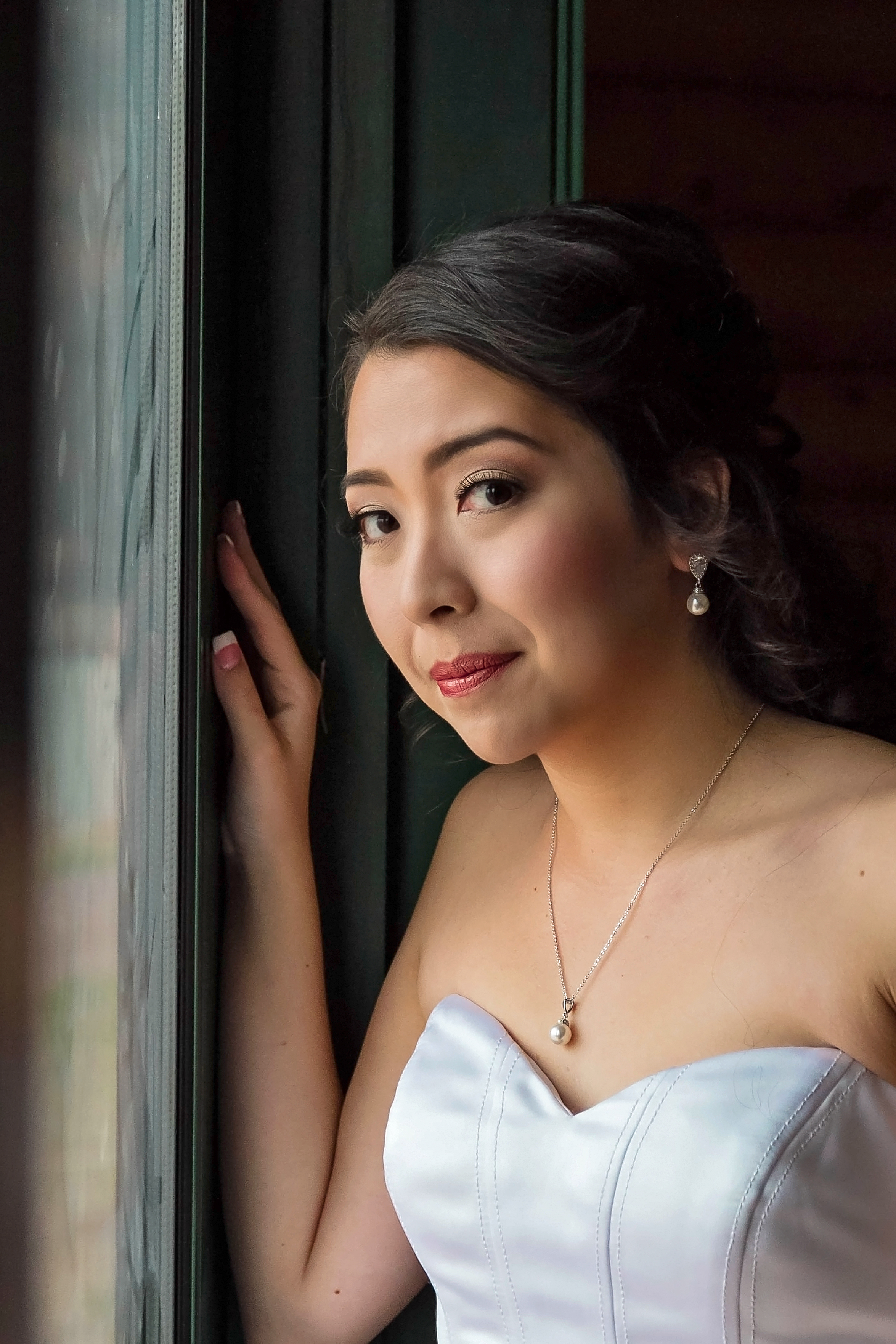 JSP Mountain Lodge Bride by a window.jpg