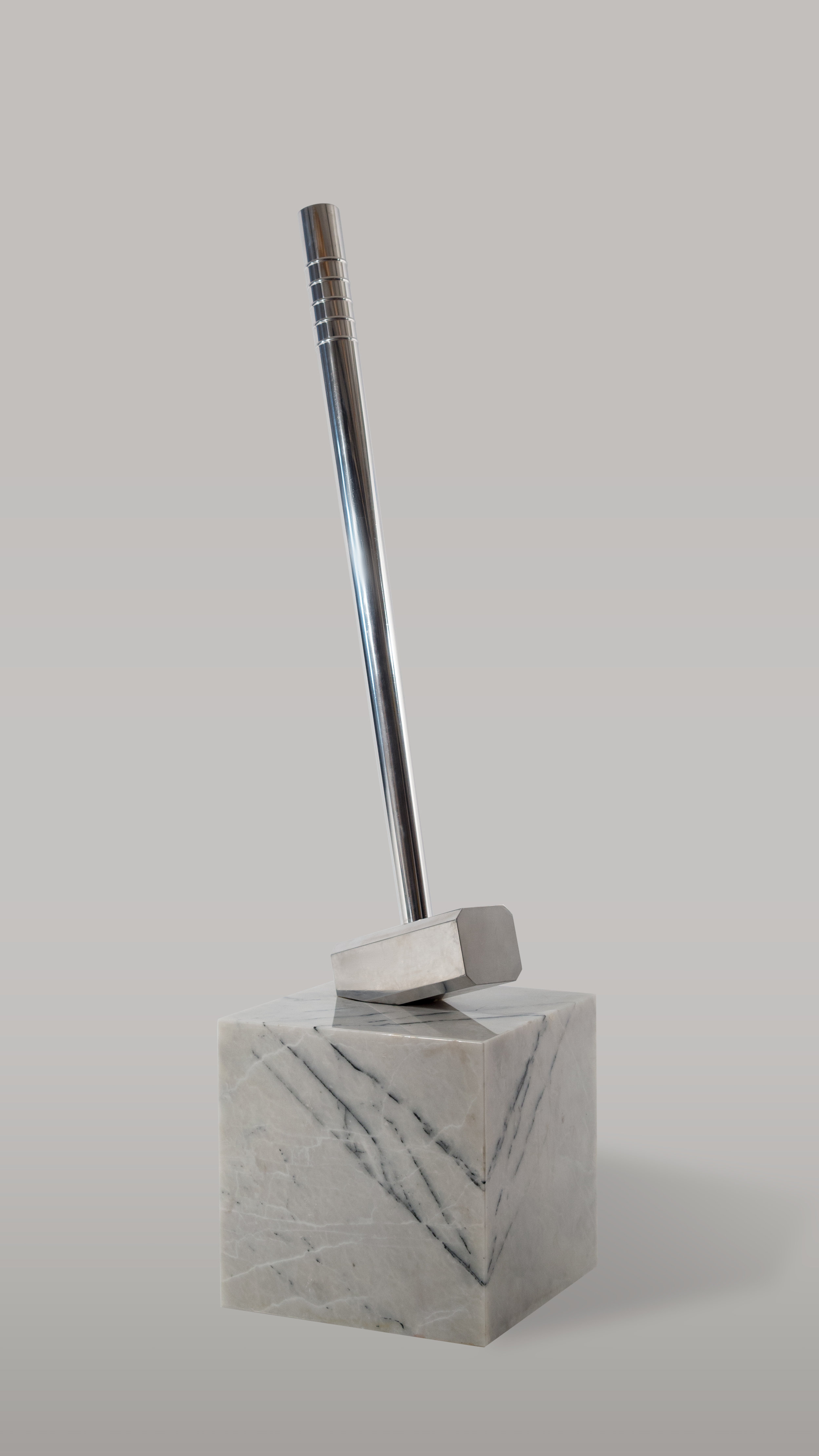 Aluminum Sledgehammer in Marble Cube, 2017. Ahmet Civelek