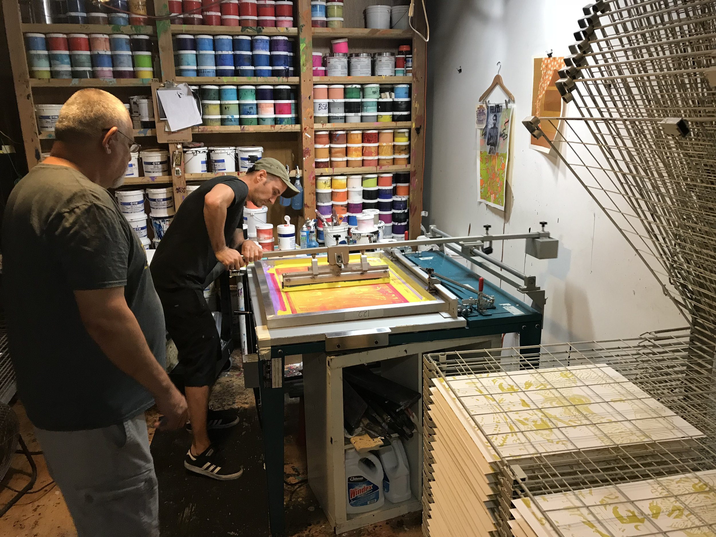 2. Start printing - Screens are burned, inks are mixed, and we're ready to roll. The decision of which layers to print first is determined by the design. Making sure parts of the artwork called