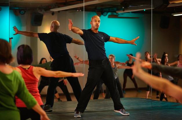 Chris Daigre leads a danceDaigre class at Community Fitness. (Benjamin Benschneider/The Seattle Times)