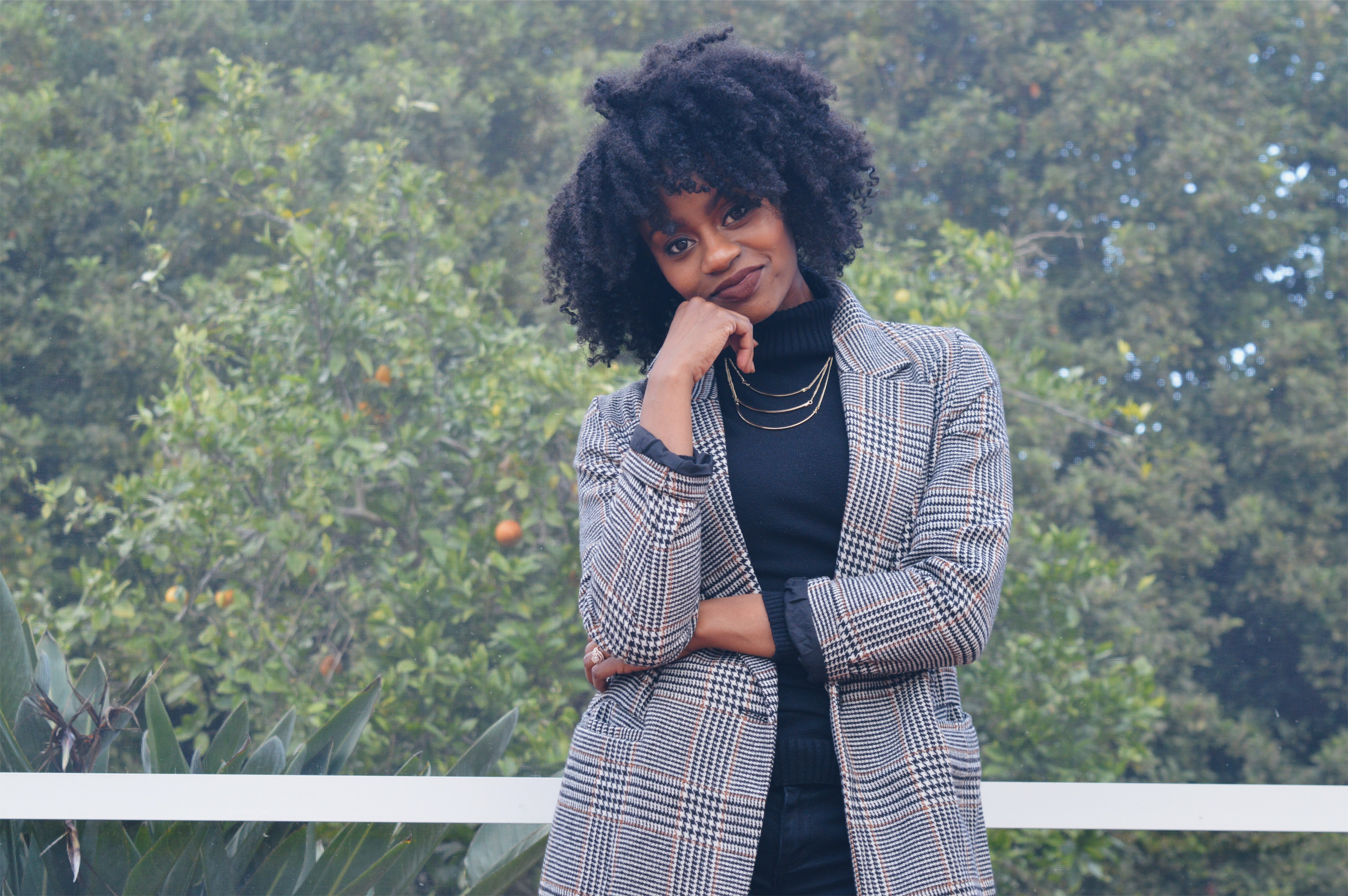 natural hair twist out black turtleneck plaid trench coat layered gold necklace milani covet lipstick
