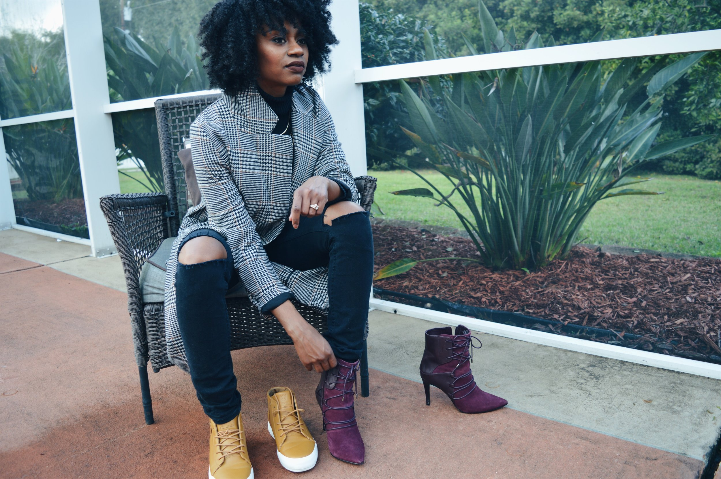 hm long plaid coat black turtle neck black distressed jeans tan sneaker wine booties natural hair