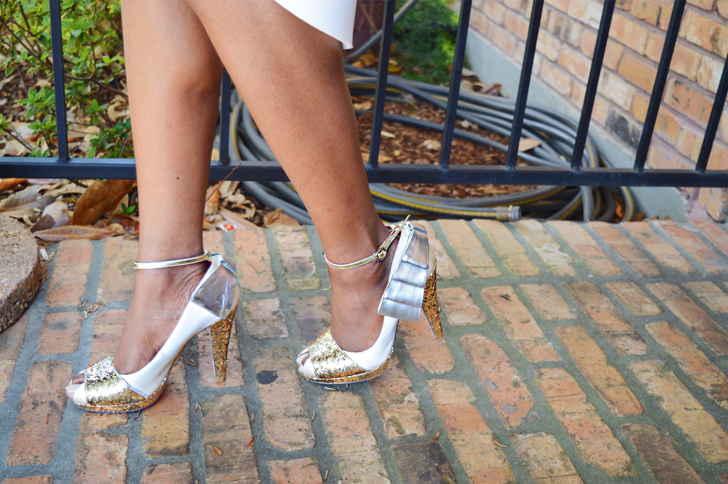 white sleeveless high low gracia dress and layered statement sleeve top natural hair ivory gold silver shoes of prey ankle strap heels