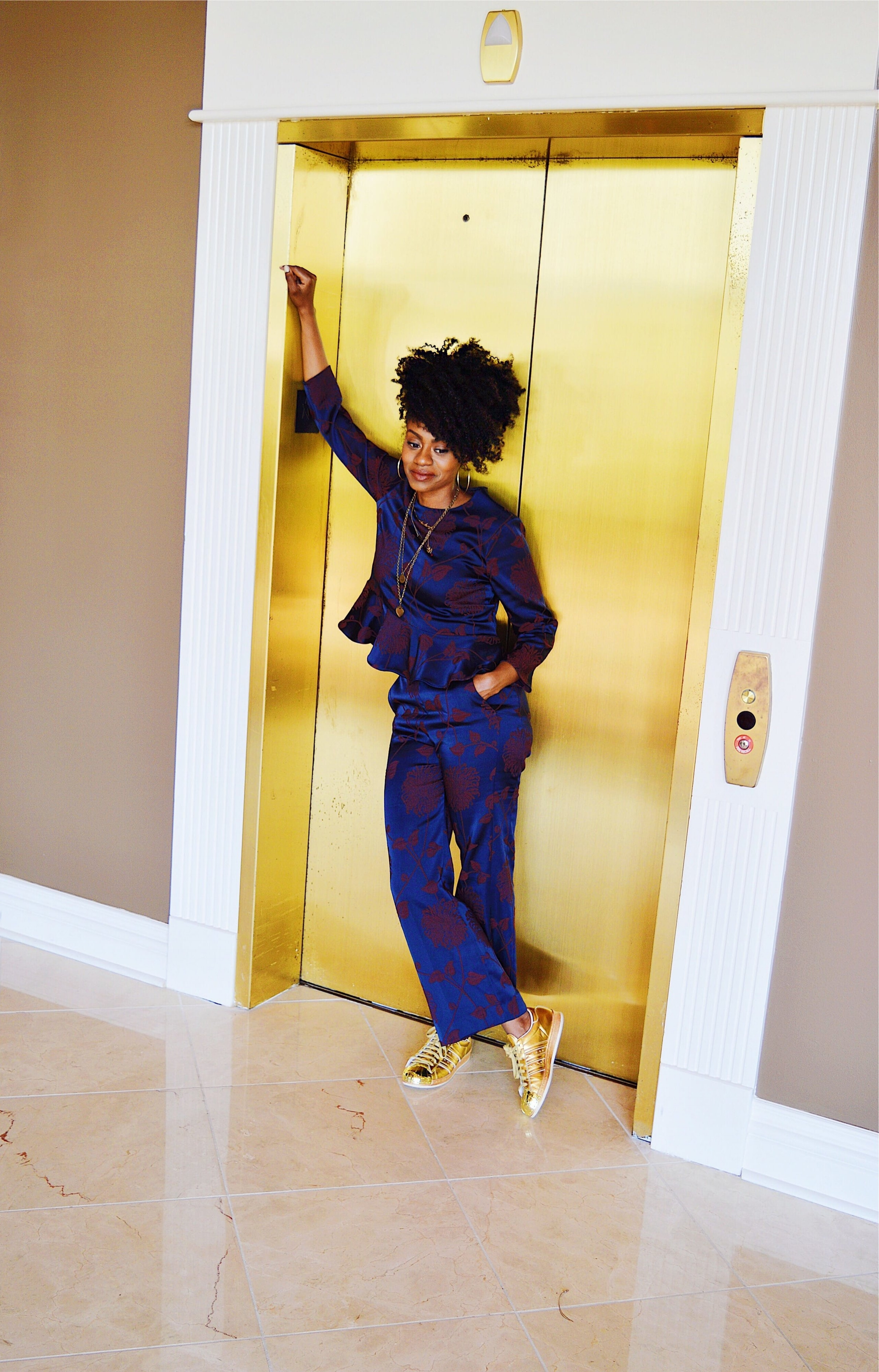 navy matching set with metallic gold adidas originals sneakers natural hair in a puff
