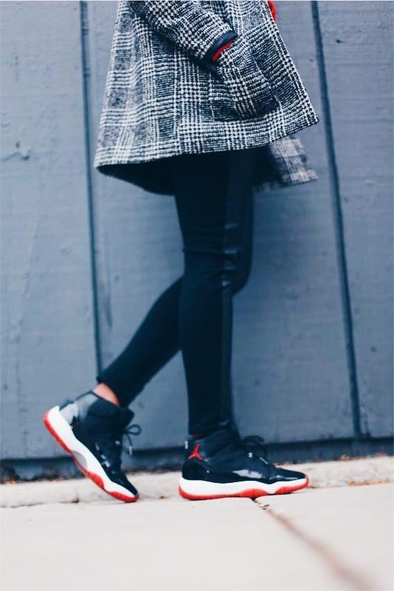 hoodie outfit red hoodie black and white plaid coat leather pants jordan 11 bred