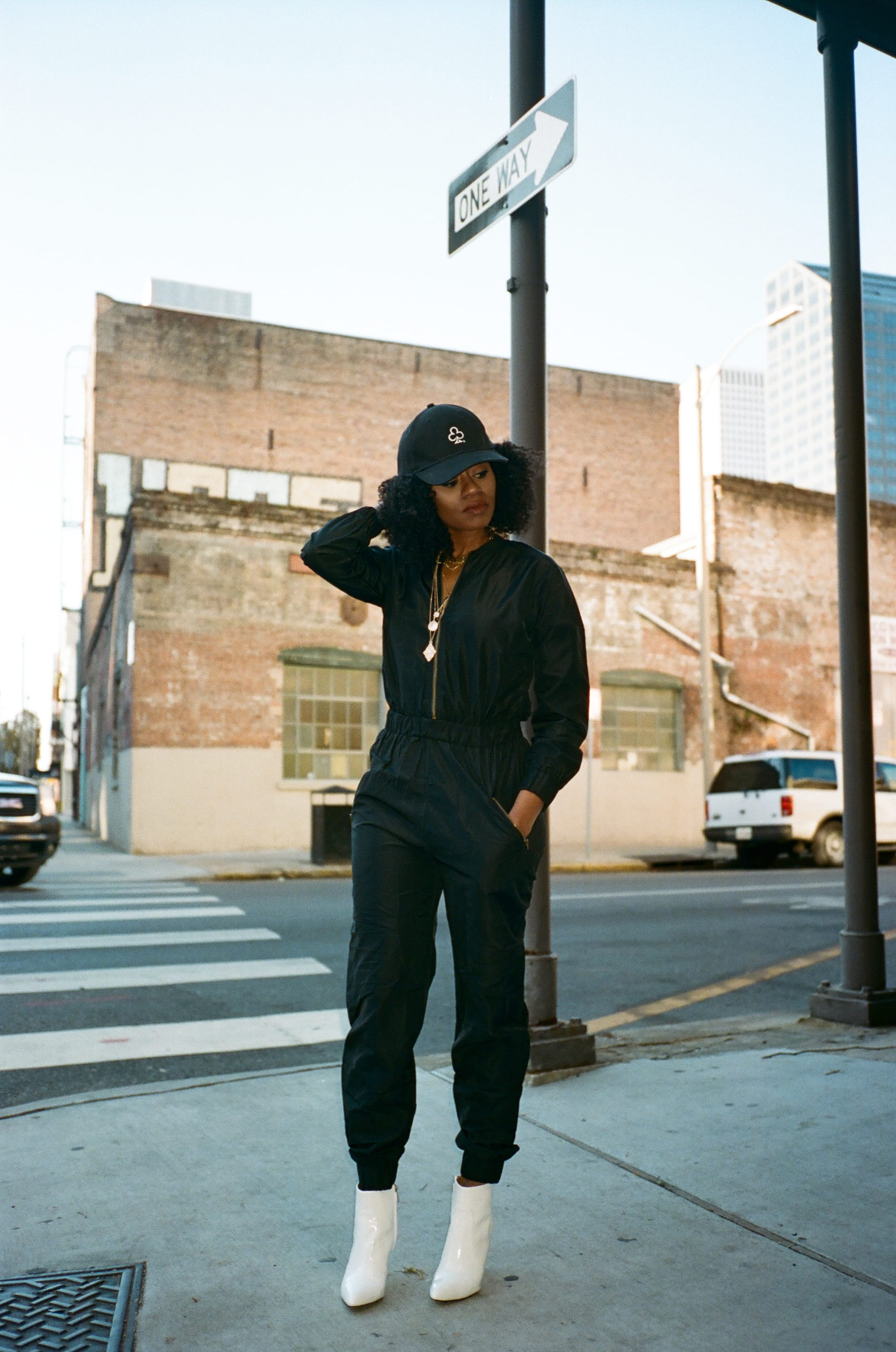 black fly jane jumpsuit white boots the loyalty club black hat anarchy street layered necklaces