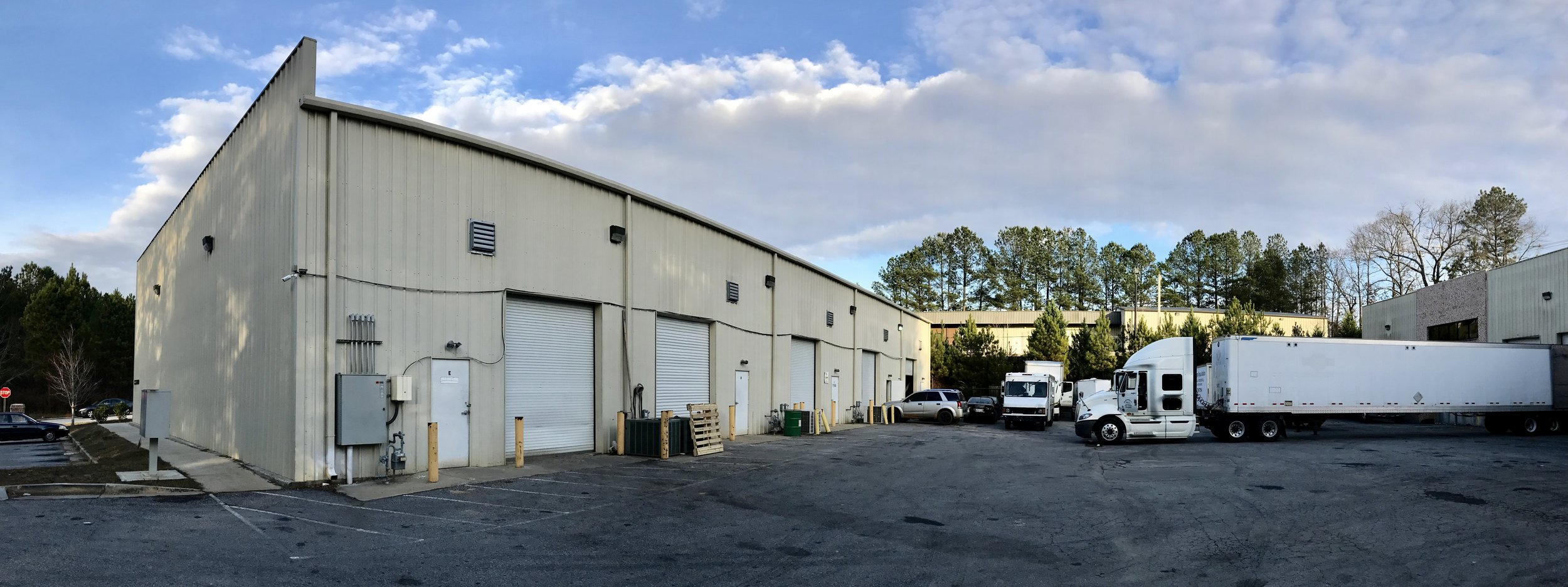 5 Roll-Up Doors on the back of each Office Warehouse Space