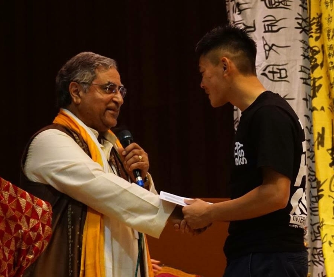 - SEACMA is proud to present the Asian Festival Scholarship for Asian American high school seniors in the Worcester County area!Johnny Bui, HS senior, accepting an award from Dr. Passey.