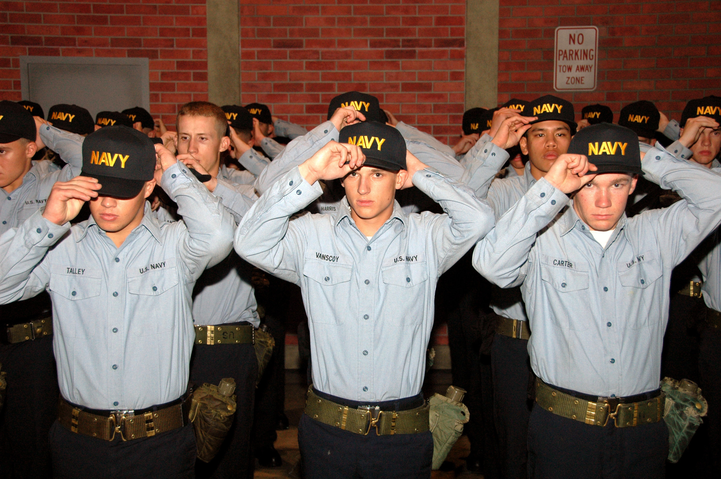 U.S._Navy_recruits_from_Division_253_place_Navy_ball_caps_on_their_heads_during_a_capping_ceremony_after_ending_training_for_Battle_Stations_21_onboard_USS_Trayer_(BST_21)_at_Naval_Station_Great_Lakes,_Ill._070814-N-IK959-071.jpg
