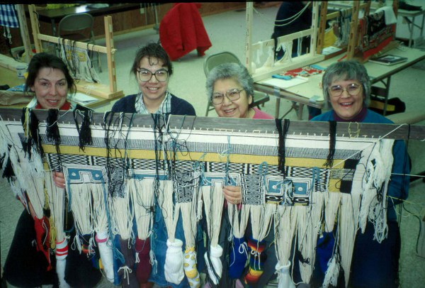 Lani Hotch, second from left, works with her community on the  Klukwan Healing Robe .