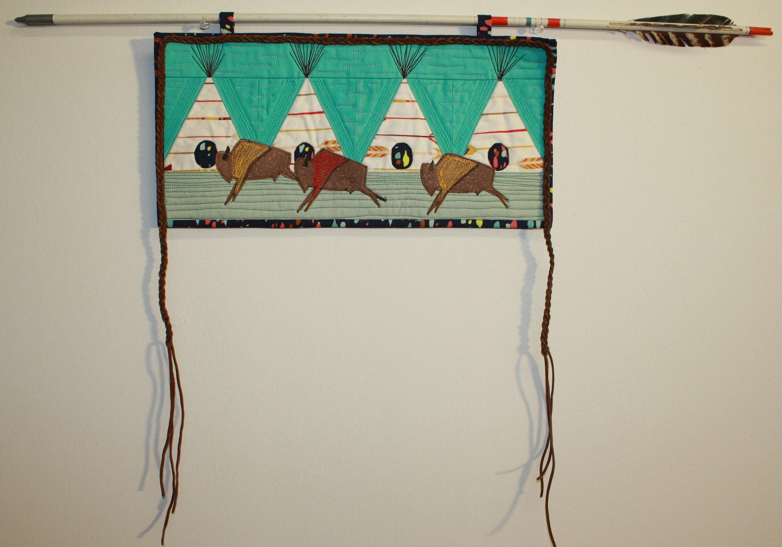 Buffalo, braids and arrows