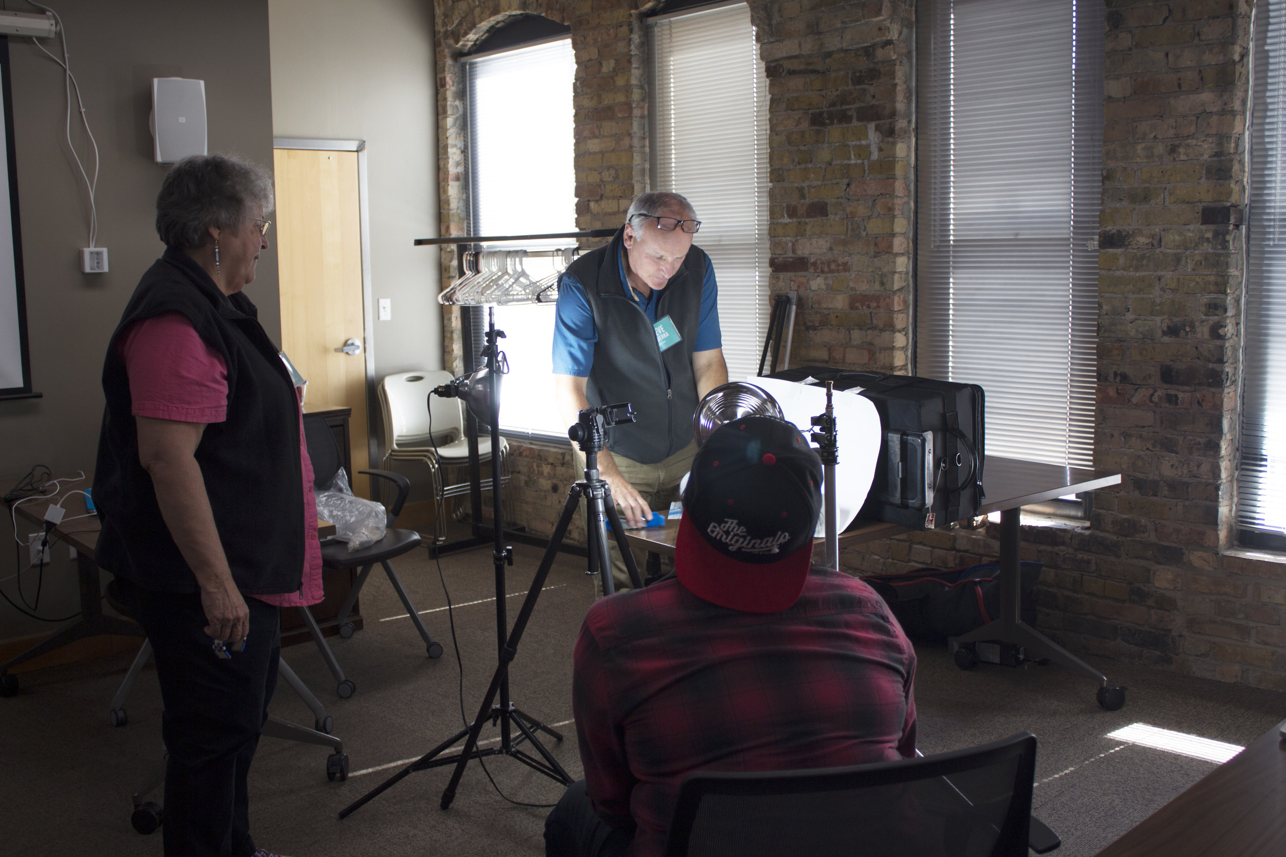 Steve Wewerka instructing fellows on photography lighting techniques.