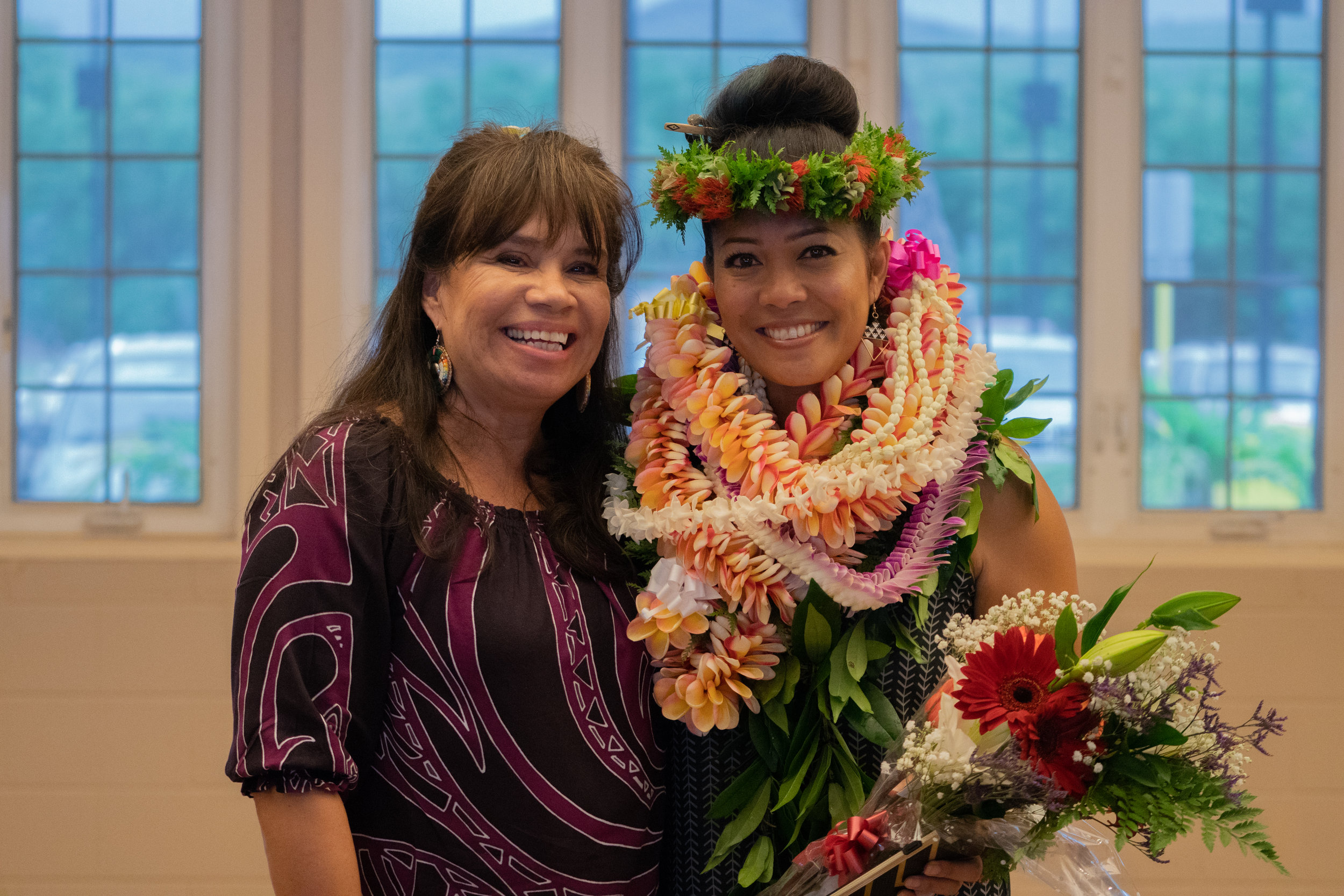 FPF President, Lori Pourier (Oglala Lakota) and 2018 Community Spirit Award Honoree, Kanoelani Davis (Native Hawaiian). Photo by Josiah Ching