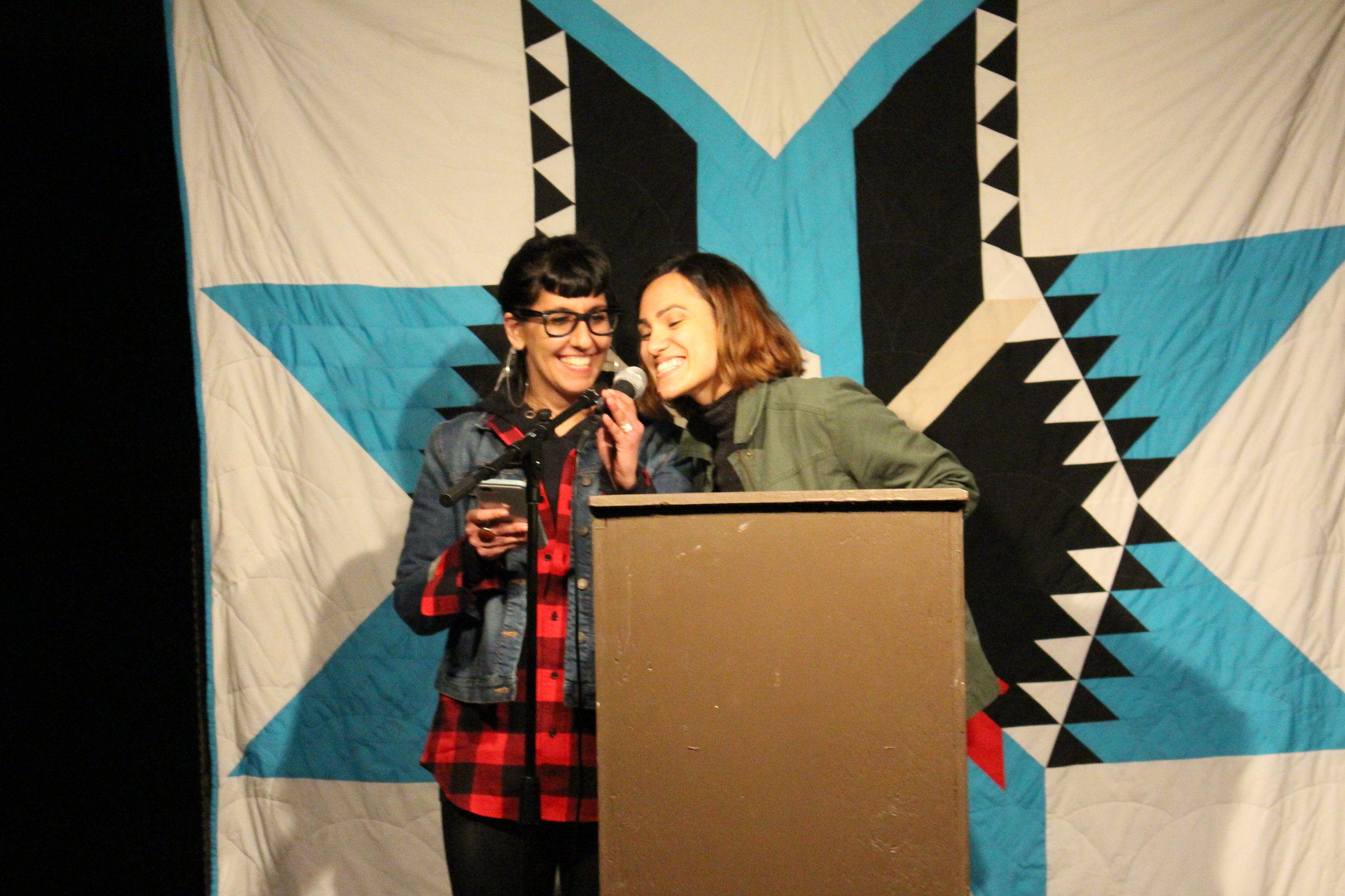 Golnesa and Laree at a Dances With Words open mic night. Photo by Cecily Engelhart (Ihanktonwan/Oglala).
