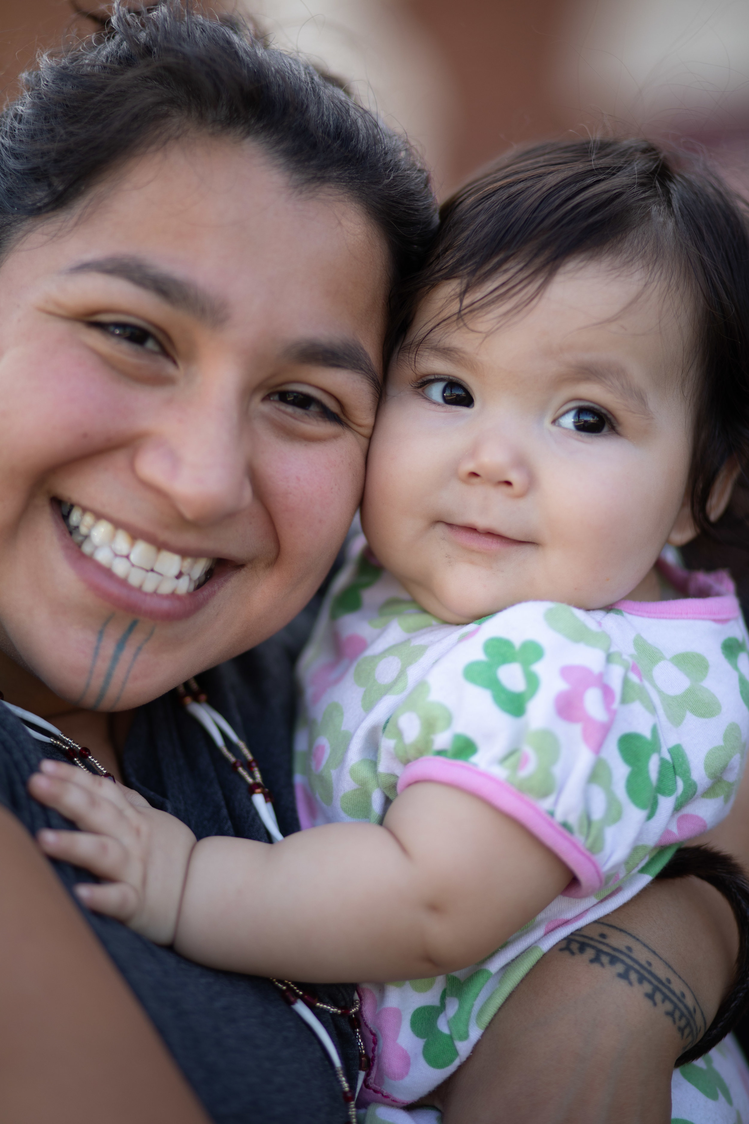 Marjorie Tahbone (Inupiaq), a community artist attending with IAE Partner, Kawerak, Inc., and her daughter.