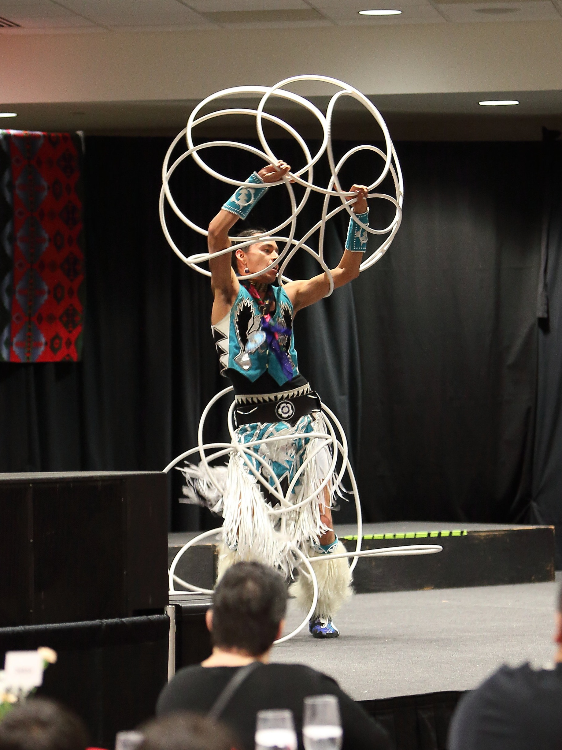 Hoop dancer performing during Miscobinayshii's honoring. Photo by Falls Portrait Art Studio.