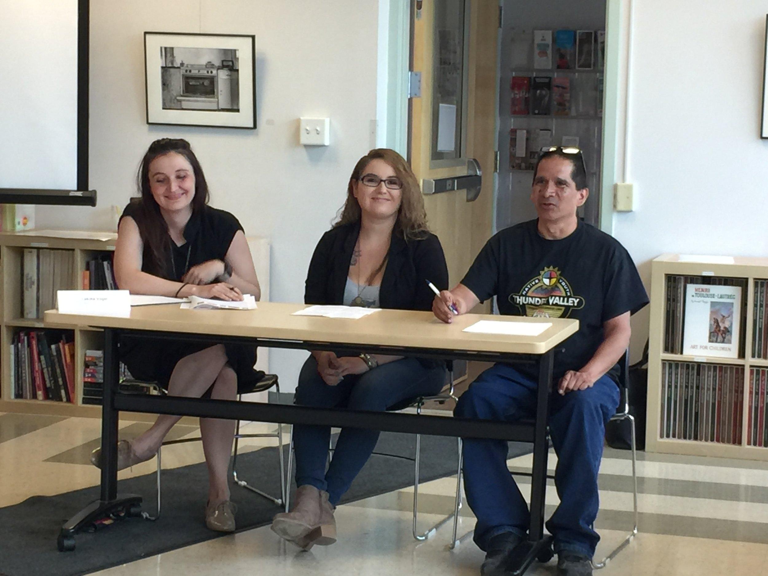 The grantee panel. Left to right: Lakota Vogel (Cheyenne River Sioux Tribe), Executive Director of Four Band Community Fund; Lexxi Hunter (Oglala Lakota), Lakota Federal Credit Union; Andrew Iron Shell (Eastern Band of Cherokee), Community Engagement Coordinator at Thunder Valley Community Development Corporation.