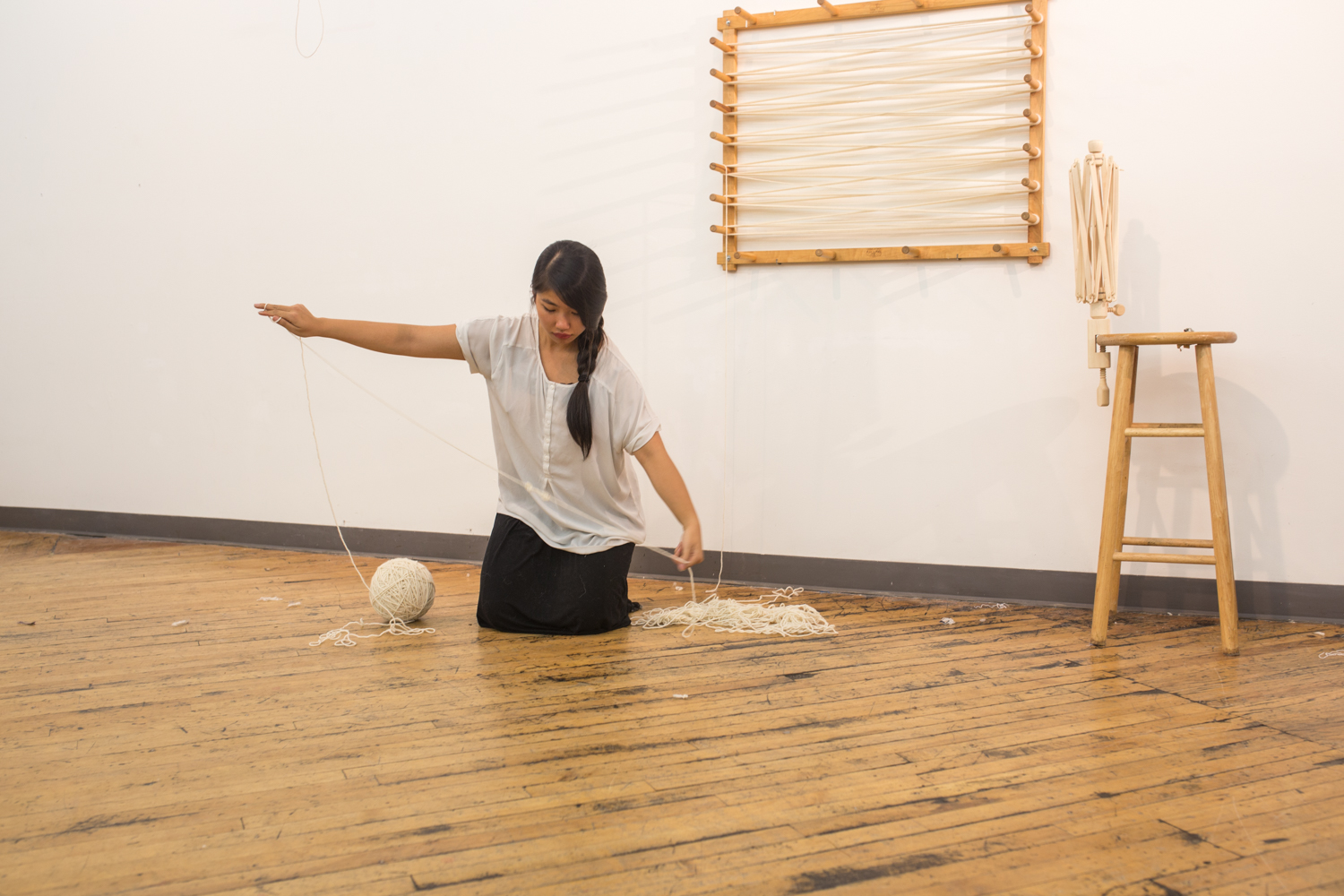 The artist focuses on untangling a knot.