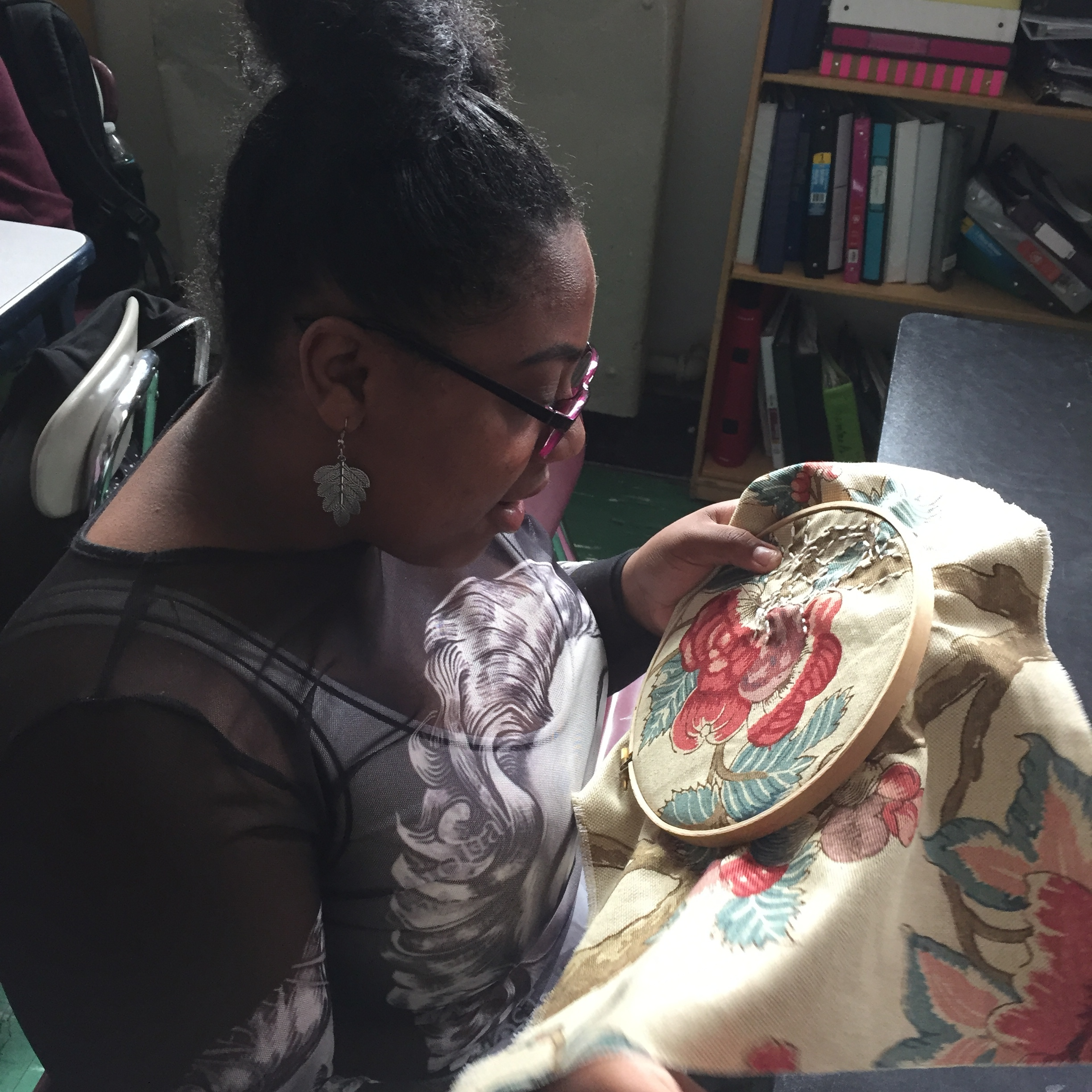 A student embroidering.