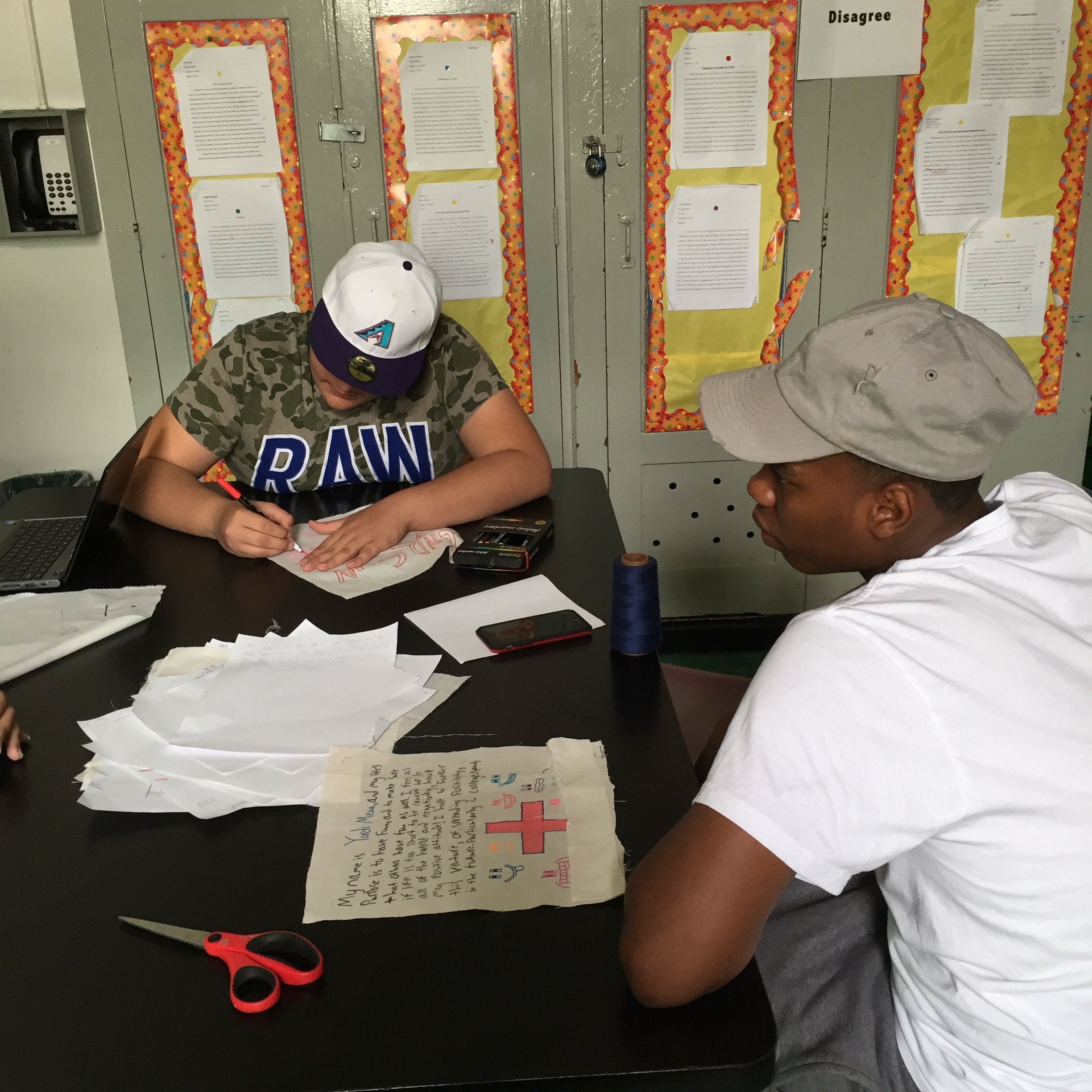 Two students working on their quilt pieces.