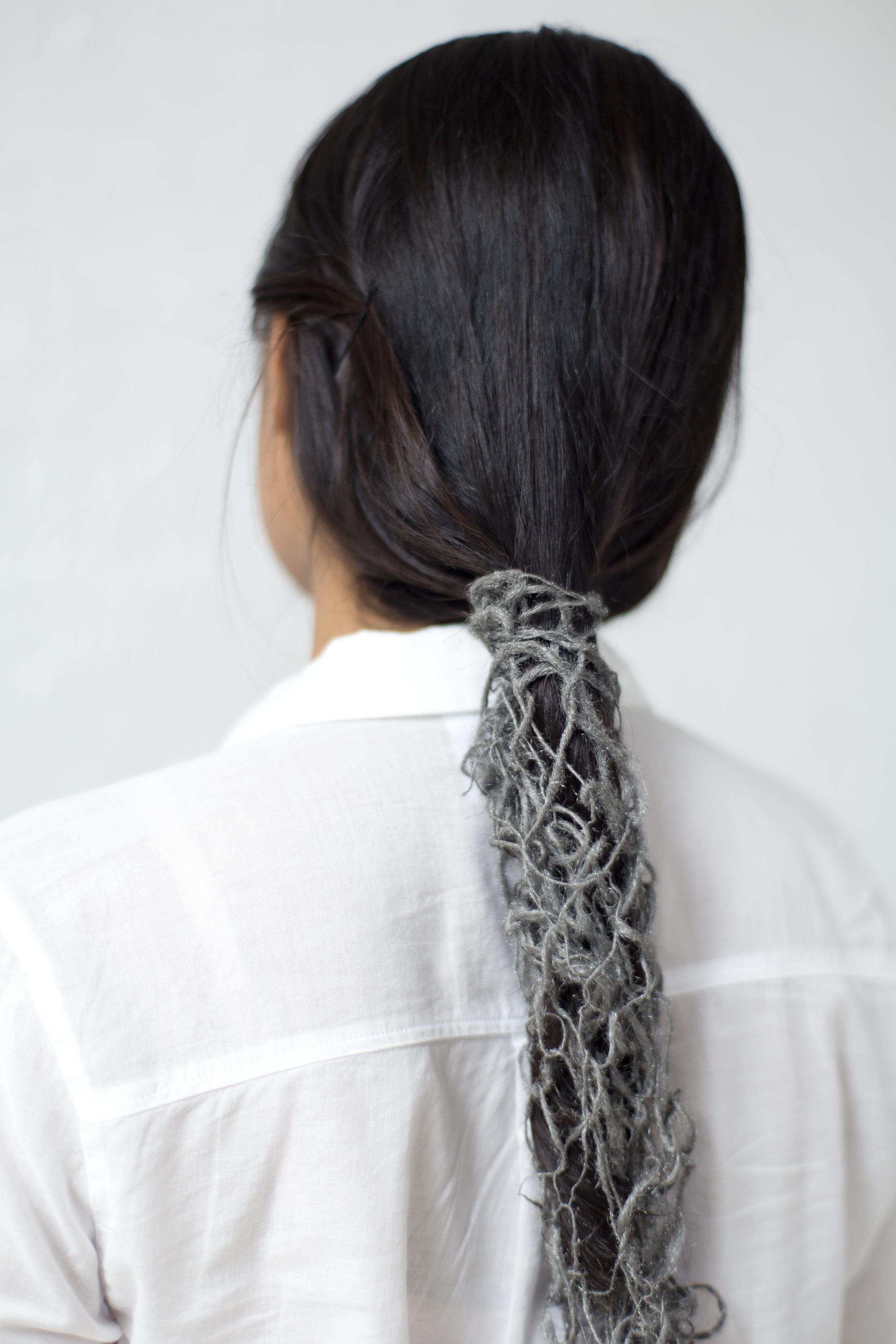 Hand-spun steel wool wrapped around Swati Kapur's hair