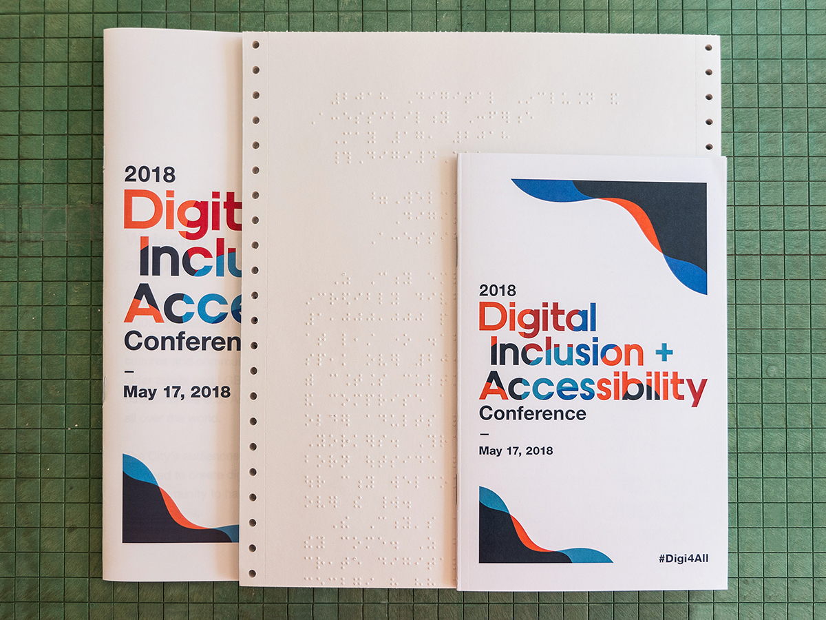 Conference program in small print, Braille, and large print